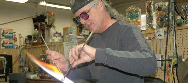 Greg Chase, a glass artist from Louisiana, shows off his technique Saturday at the Marble Crazy event.