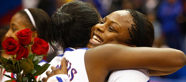 Kansas senior Danielle McCray hugs teammate Annette Davis during a ceremony recognizing the seniors following the game against Texas A&M on Saturday, March 6, 2010, at Allen Fieldhouse.