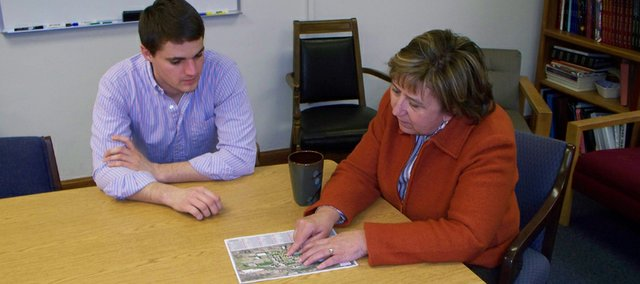 University of Nebraska-Lincoln senior Matt Pederson looks over a map of the university's 32 Greek living units on campus with Linda Schwartzkopf, the university's director of Greek affairs. All fraternities and sororities at UNL have agreed to follow the university's no alcohol rules, which they say has resulted in cleaner and safer living conditions