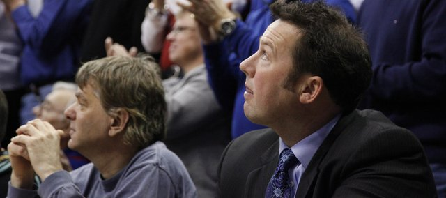 Rodney Jones, assistant athletics director with the Williams Educational Fund, watches pregame introductions from his courtside seat prior to tipoff for the Jayhawks' game against Oklahoma, Monday, Feb. 20, 2010 at Allen Fieldhouse.