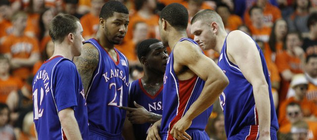 Kansas players Brady Morningstar, left, Markieff Morris, Sherron Collins, Xavier Henry and Cole Aldrich huddle during a break from an Oklahoma State run in the first half, Saturday, Feb. 27, 2010 at Gallagher-Iba Arena in Stillwater.