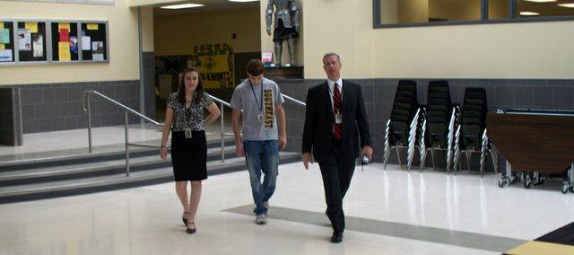 Southeast Lincoln High School sophomore Jessica Greer, sophomore Brendon Henning and principal Pat Hunter-Pirtle walk through the school's hallways. Lincoln public schools encourage good behavior in students, including dealing with alcohol.
