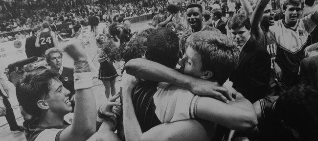 The Kansas basketball team celebrates defeating Oklahoma to win the 1988 NCAA Championship.