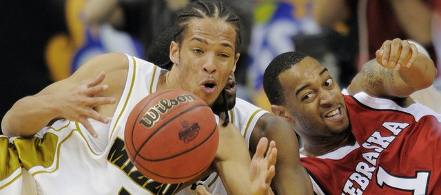 Missouri guard Mike Dixon (10) and Nebraska guard Eshaunte Jones (1) fight for a loose ball at the Big 12 Conference tournament on Wednesday, March 10, 2010, in Kansas City, Mo.