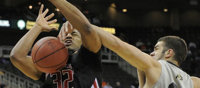 Texas Tech forward Mike Singletary (32) is fouled by Colorado forward Casey Crawford (34) at the Big 12 Conference Tournament Wednesday, March 10, 2010, in Kansas City, Mo.