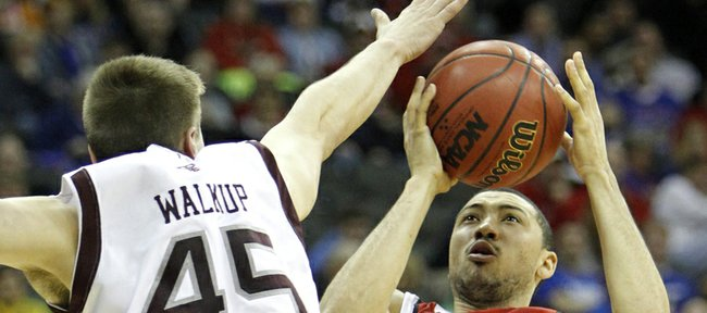 Nebraska guard Ryan Anderson (44) shoots over Texas A&M forward Nathan Walkup (45) during the first half of an NCAA college basketball game at the Big 12 tournament Thursday in Kansas City, Mo.