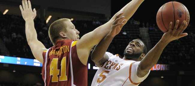 Texas forward Damion James (5) tries to shoot over Iowa State center Justin Hamilton (41) during the second half of an NCAA college basketball game at the Big 12 tournament Wednesday, March 10, 2010, in Kansas City, Mo.