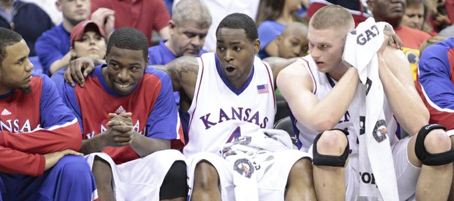 Kansas guard Sherron Collins, second from right, celebrates with teammates Cole Aldrich, right, Elijah Johnson and C.J. Henry in the closing minutes of the Jayhawks' 79-66 win over Texas A&M on Friday in Kansas City, Mo.