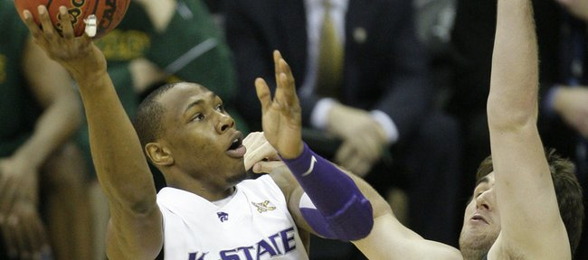 Kansas State forward Dominique Sutton (23) shoots over Baylor center Josh Lomers (50) during the first half of an NCAA college basketball game at the Big 12 tournament Friday, March 12, 2010, in Kansas City, Mo.