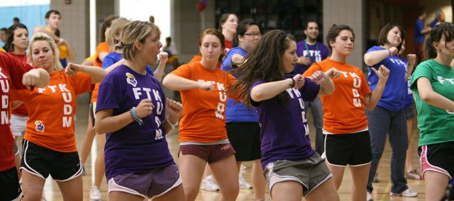 Students practice a dance routine they learned during the 2009 KU Dance Marathon.