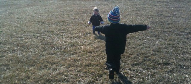 Erin Curtis-Dierks' children play outdoors in Lawrence. Their mother says they limit technology fairly well, with limited TV time and a game on the Wii once a week or less.