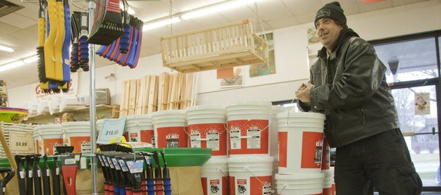 Lawrence resident Randy McMechan picks up a bucket of Ice Melt on Monday at Cottin's Hardware and Rental, 1832 Mass., in expectation of severe winter weather. The National Weather Service in Topeka has issued a winter storm warning for Douglas County until 6 a.m. Wednesday.