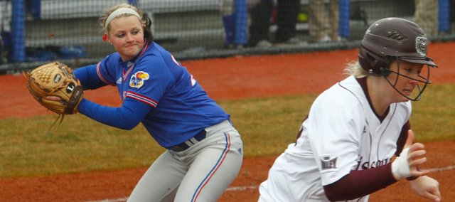 KU&#39;s Marissa Ingle looks over to first base to throw out a Missouri State batter during the game on Sunday, March 14, 2010.