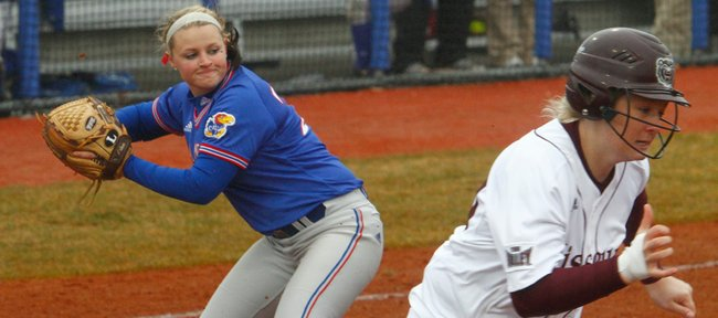 KU's Marissa Ingle looks over to first base to throw out a Missouri State batter during the game on Sunday, March 14, 2010.