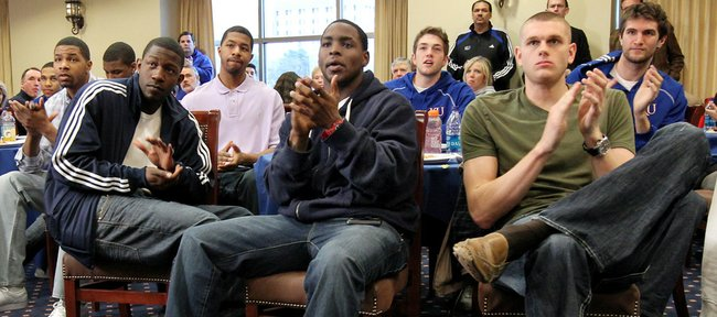 KU players, from left, Marcus Morris, Mario Little, Markieff Morris, Sherron Collins, Jordan Juenemann, Cole Aldrich and Jeff Withey react to their NCAA Tournament seeding.