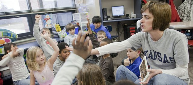 Amanda Vail, a second-grade teacher at Prairie Park school, quizzes her students on toads and frogs in class on Thursday. Vail, who is completing her third year in the district, isn't sure where, or whether, she'll be teaching in the district next year because of budget cuts.