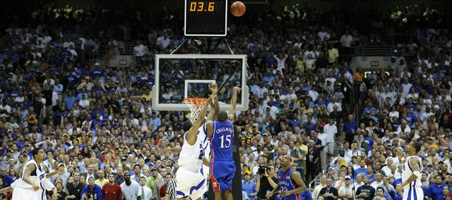 Kansas guard Mario Chalmers elevates for a three-pointer in the remaining seconds of regulation Monday, April 7, 2008 at the Alamodome in San Antonio. Chalmers swished the three to send the game into overtime.