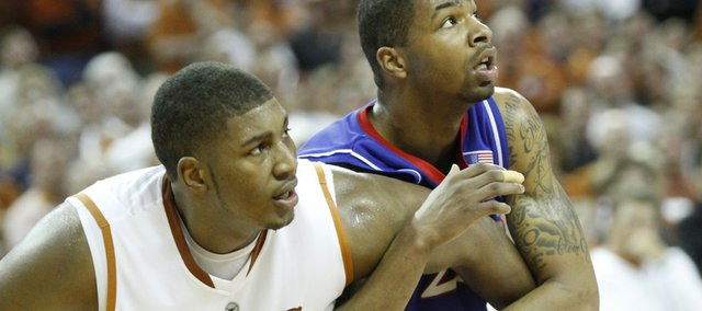 Kansas forward Marcus Morris tangles with Texas center Dexter Pittman during the second half, Monday, Feb. 8, 2010 at the Frank Erwin Center in Austin.