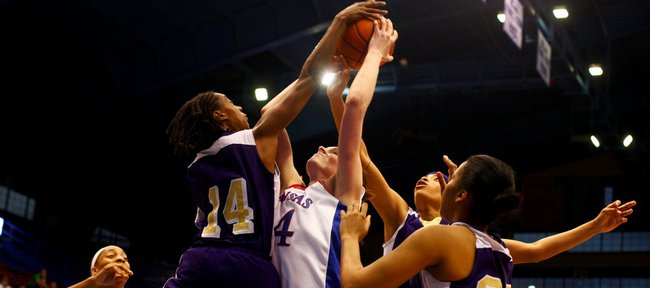KU center Krysten Boogaard is swarmed by PVAMU defenders while putting up a shot in the lane during the WNIT game on Wednesday, March 17, 2010, at Allen Fieldhouse.