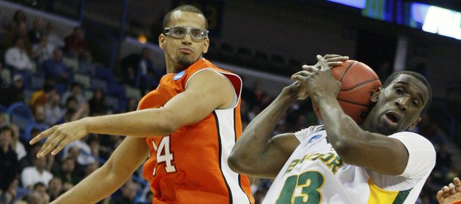 Baylor center Ekpe Udoh (13) grabs a rebound in front of Sam Houston State forward Gilberto Clavell (14) during an NCAA first-round college basketball game in New Orleans, Thursday, March 18, 2010. Udoh scored 20-points in the Bears victory.