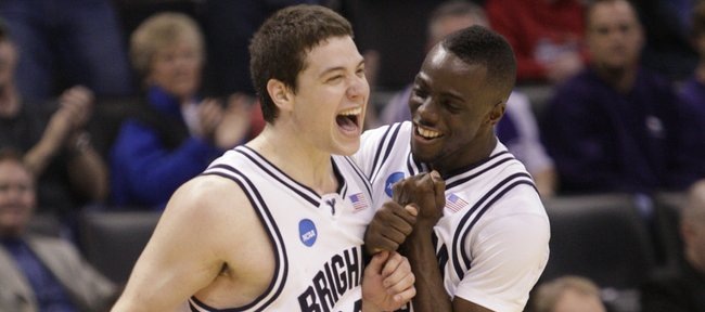 Brigham Young teammates Jimmer Fredette, left, and Michael Loyd Jr. celebrate the Cougars first-round win over Florida following the second overime, Thursday, March 18, 2010 at the Ford Center.