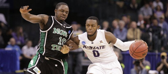 Kansas State guard Jacob Pullen drives up the court against North Texas guard Josh White during the second half Thursday, March 18, 2010 at the Ford Center in Oklahoma City.