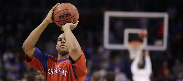 Kansas guard Xavier Henry puts up a shot during warmups prior to the Jayhawks&#39; first-round game against Lehigh, Thursday, March 18, 2010 at the Ford Center in Oklahoma City .