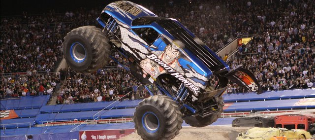 Jimmy Creten operates his monster truck, Bounty Hunter, during a show in Las Vegas in 2009. Creten and his wife, Dawn, who drives Scarlet Bandit, will be competing today and Saturday at the Monster Jam Thunder Nationals in Wichita's Intrust Bank Arena.