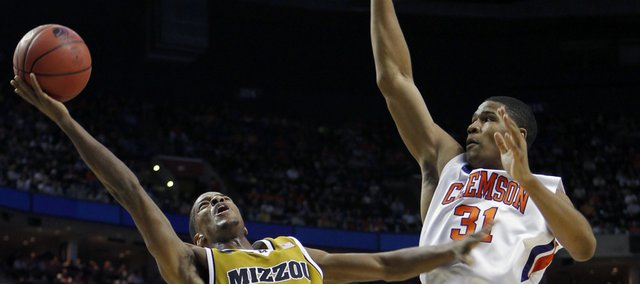 Missouri's Kim English (24) takes a shot as Clemson's Devin Booker (31) defends during the first half of an NCAA first-round college basketball game in Buffalo, N.Y., on Friday, March 19, 2010.