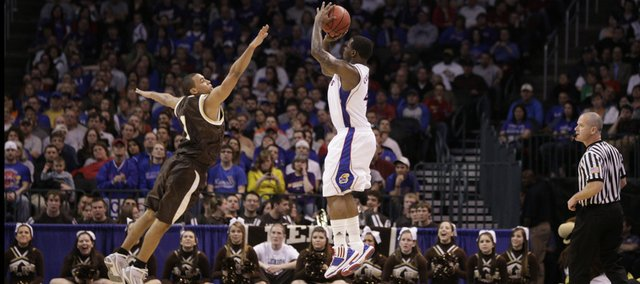 Kansas guard Sherron Collins takes a three-pointer over Lehigh guard Marquis Hall during the first half Thursday, March 18, 2010 at the Ford Center in Oklahoma City.