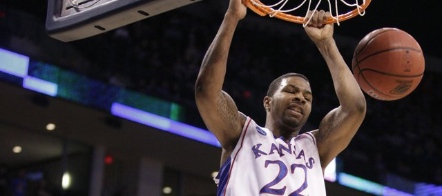Kansas forward Marcus Morris delivers a dunk on Lehigh defenders Gabe Knutson, left, and Zahir Carrington during the second half Thursday, March 18, 2010 at the Ford Center in Oklahoma City.
