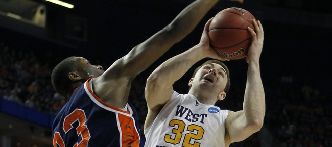 West Virginia's Dalton Pepper (32) drives on Morgan State's Troy Smith (23) during the first half of an NCAA first-round college basketball game in Buffalo, N.Y., on Friday, March 19, 2010.