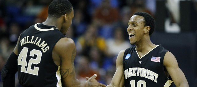 Wake Forest guard Ishmael Smith (10) is congratulated by guard L.D. Williams (42) after making a shot during an NCAA college basketball game against Texas in New Orleans, Thursday, March 18, 2010.