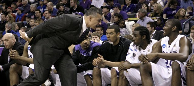 Kansas State head basketball coach Frank Martin yells at forward Curtis Kelly (24) during the first half of an NCAA second-round college basketball game against BYU, Saturday, March 20, 2010, in Oklahoma City.