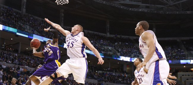 Kansas center Cole Aldrich defends a shot by Northern Iowa guard Kwadzo Ahelegbe during the first half Friday, March 20, 2010 at the Ford Center in Oklahoma City.