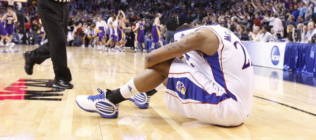 Kansas forward Marcus Morris covers his head after the Jayhawks' 69-67 loss to Northern Iowa Friday, March 20, 2010 at the Ford Center in Oklahoma City.