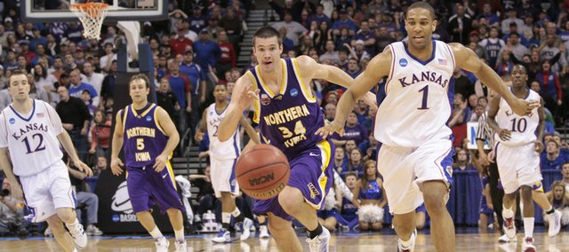 University of Northern Iowa's Adam Koch (34), left, and Kansas guard Xavier Henry (1) run for a loose Saturday, March 20, 2010, in Oklahoma City.