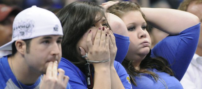 Kansas fans watch the final seconds of KU's 67-69 loss in the second round to University of Northern Iowa, Saturday, March 20, 2010, in Oklahoma City.