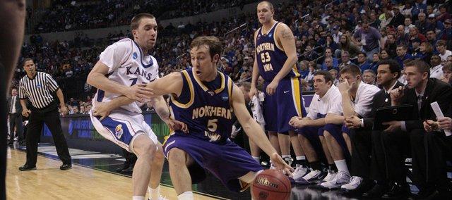 Kansas guard Brady Morningstar (12) defends UNI's Ali Farokhmanesh (5) Saturday, March 20, 2010, in Oklahoma City, OK.