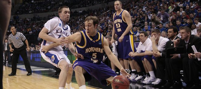 Kansas guard Brady Morningstar (12) defends UNI's Ali Farokhmanesh (5) Saturday, March 20, 2010, in Oklahoma City, OK.