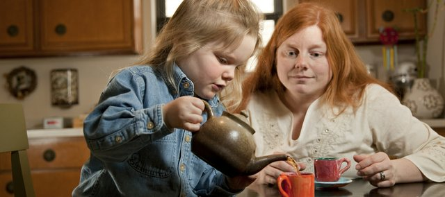 Cami Kennedy watches as her three-year-old daughter Suzana pours a cup of tea for herself. Kennedy says her daughter has been drinking decaffeinated tea for as long as she can remember.