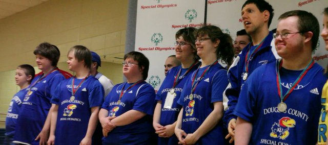 One of Five squads of basketball teams wins second-place medals Saturday at the Douglas County Special Olympics State Basketball and Cheerleading Tournament in Hays.