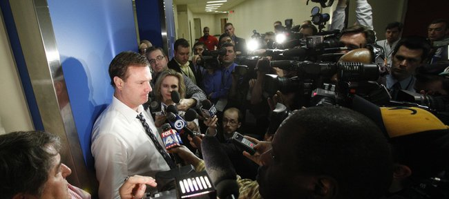 Kansas head coach Bill Self speakers with media members outside the locker room following the Jayhawks' 69-67 loss to Northern Iowa, Saturday, March 20, 2010 at the Ford Center in Oklahoma City.