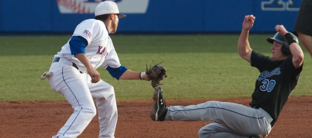 KU shortstop Brandon Macias gets a tag down on a Creighton baserunner for an out in the game on Saturday, March 23, 2010.