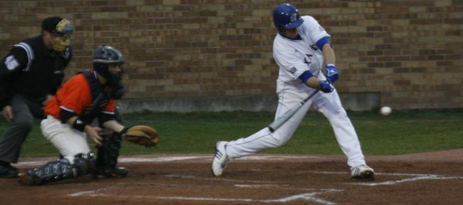 Kansas' Alex DeLeon (34) swings to hit a low pitch while playing against Baker University at Hoglund Ballpark on March 24, 2010. The Jayhawks won in five innings, 16-0.