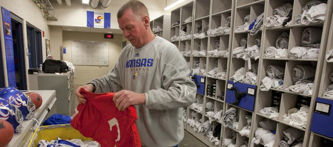 Jeff Himes, head football equipment manager, finds the practice jersey belonging to quarterback Kale Pick on Wednesday in preparation for the start of spring drills. The preseason workouts begin Saturday.