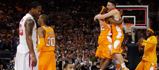 Tennessee's Scotty Hopson, left, and Steven Pearl embrace after their 76-73 win over Ohio State of an NCAA Midwest Regional college basketball game Friday, March 26, 2010, in St. Louis. At left are Ohio State players David Lighty (23) and Evan Turner (21).