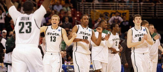 Michigan State players celebrate in the closing seconds of their 59-52 win over Northern Iowa in an NCAA Midwest Regional college basketball game Friday, March 26, 2010, in St. Louis.