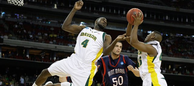 Baylor's Quincy Acy, left, and Tweety Carter, right, go for a rebound against Saint Mary's Omar Samhan during the first half of an NCAA South Regional semifinal college basketball game in Houston, Friday, March 26, 2010.