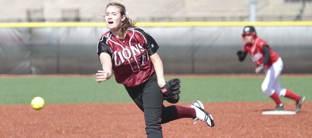 Lawrence High pitcher Lauren Massey delivers to the plate in the second inning. The Lions fell to Shawnee Mission North, 4-2 and 3-2, on Thursday at Lawrence High.